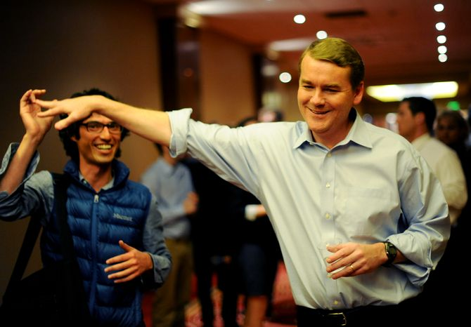 Senate candidate Michael Bennet, right, greets a supporter during an election night watch party in Denver, T