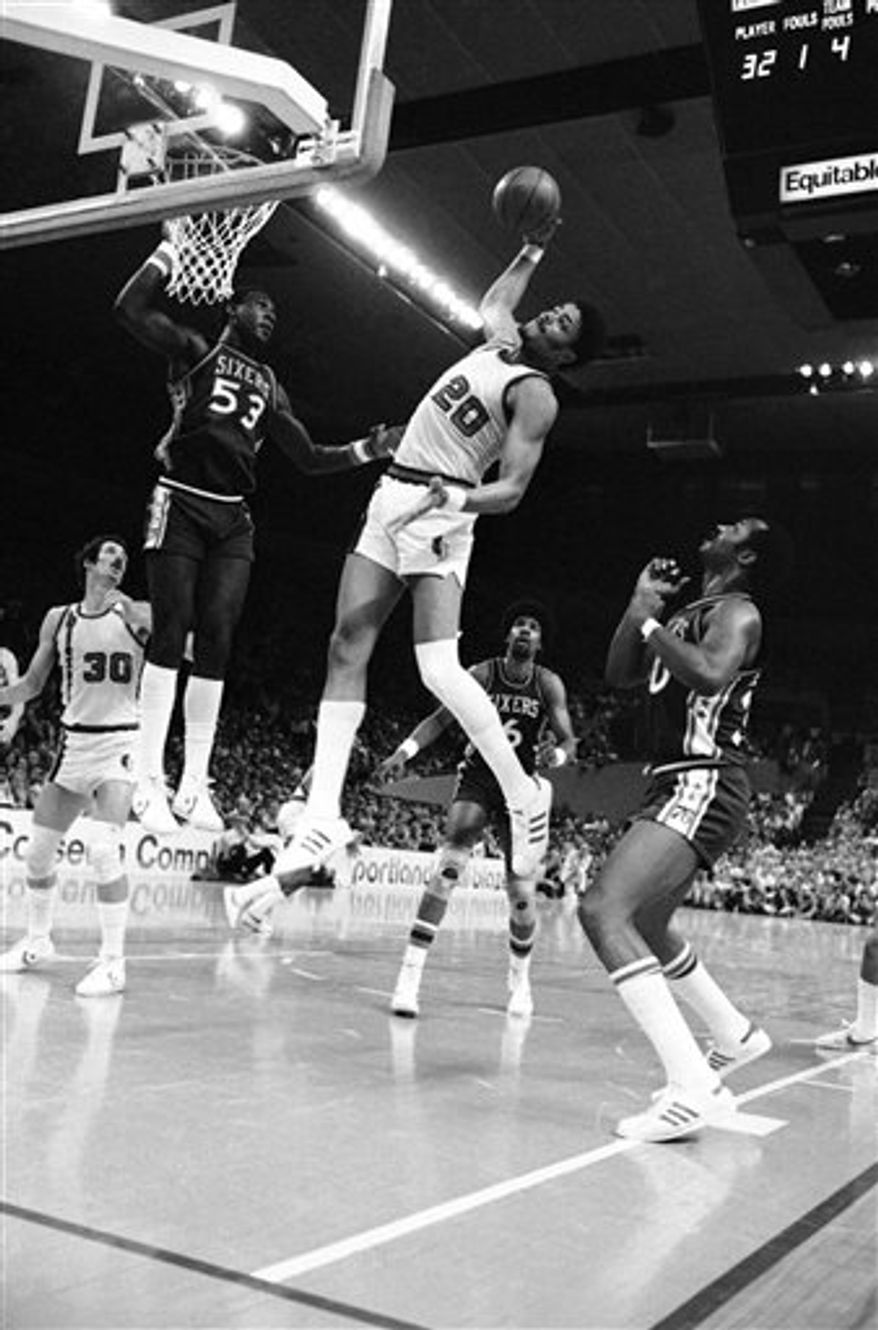 FILE- This jan. 12, 1979 file photo shows Portland Trail Blazers' Maurice Lucas driving hard past Boston Celtics' Marvin Barnes (27) and Chris Ford on his way for two points in second period NBA action at the Boston Garden.  Lucas, the fierce power forward who helped lead the Portland Trail Blazers to the 1977 NBA title, has died after a long fight with bladder cancer. He was 58.The Trail Blazers said Lucas died Sunday Oct. 31, 2010. (AP Photo/Paul Benoit,File)