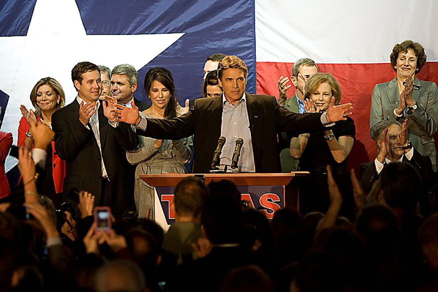 Texas Gov. Rick Perry celebrates his re-election with his family and other officeholders who won re-election during his acceptance speech at the Texas Disposal Systems Exotic Game Ranch in Buda, Texas, on Tuesday, Nov. 2, 2010. (AP Photo/Ralph Barrera, Austin American-Statesman)