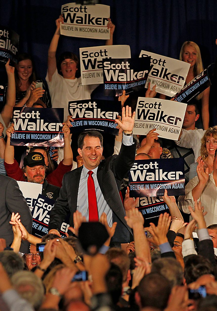 Supporters cheer as Wisconsin Republican gubernatorial candidate Scott Walker enters his victory party, Tuesday, Nov, 2,  2010, in Pewaukee, Wis.  (AP Photo/Jeffrey Phelps)