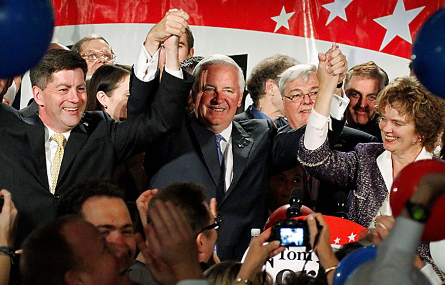 Pennsylvania Gov.-elect Republican Tom Corbett, center, his wife Susan, right, celebrate with Lt. Gov.- elect Jim Cawley, left, after announcing his victory over Democrat Dan Onorato in Pittsburgh, Tuesday, Nov. 2, 2010. (AP Photo/Gene J. Puskar)