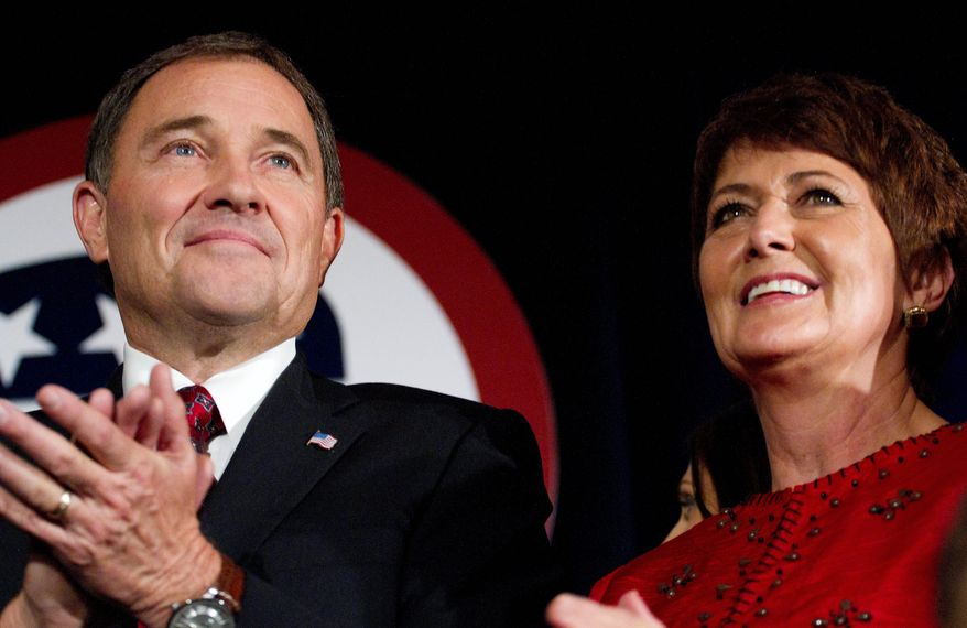 Utah Governor Gary Herbert, left, with his wife Jeanette Herbert, celebrates his victory over Democratic candidate Peter Corroon Tuesday, Nov. 2, 2010, in Salt Lake City. (AP Photo/Jim Urquhart)