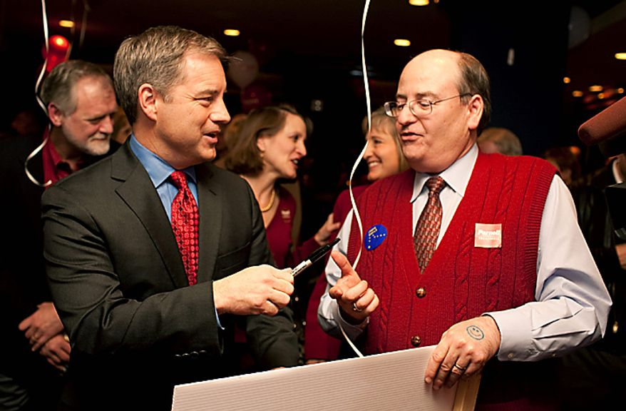 Alaska Governor Sean Parnell, left, greets supporter David Morgan Tuesday night, Nov. 2, 2010, in Anchorage as voters wait for the polls to close. (AP Photo/ James Mason)