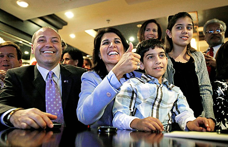 Republican candidate for South Carolina governor Nikki Haley, second from left, watches election results come in after the polls closed from a hotel restaurant with her husband Michael, from left, son Nalin, 9, and daughter Rena, 12, Tuesday, Nov. 2, 2010, in Columbia, S.C. (AP Photo/David Goldman)