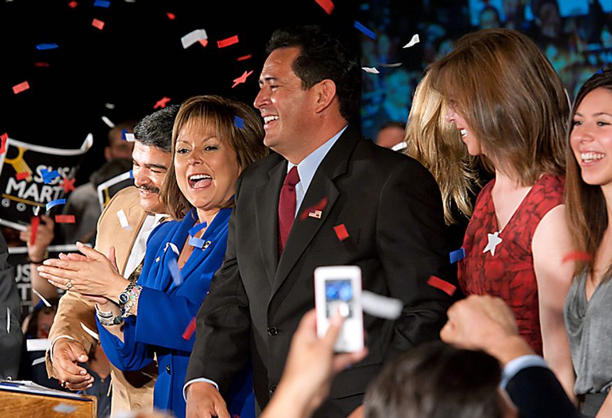 New Mexico Republican Governor-elect Susana Martinez, center left, celebrates with supporters, accompanied by Lt. Governor-elect John Sanchez, center right, in Las Cruces, N.M. on Tuesday, Nov. 2, 2010. (AP Photo/William Faulkner)