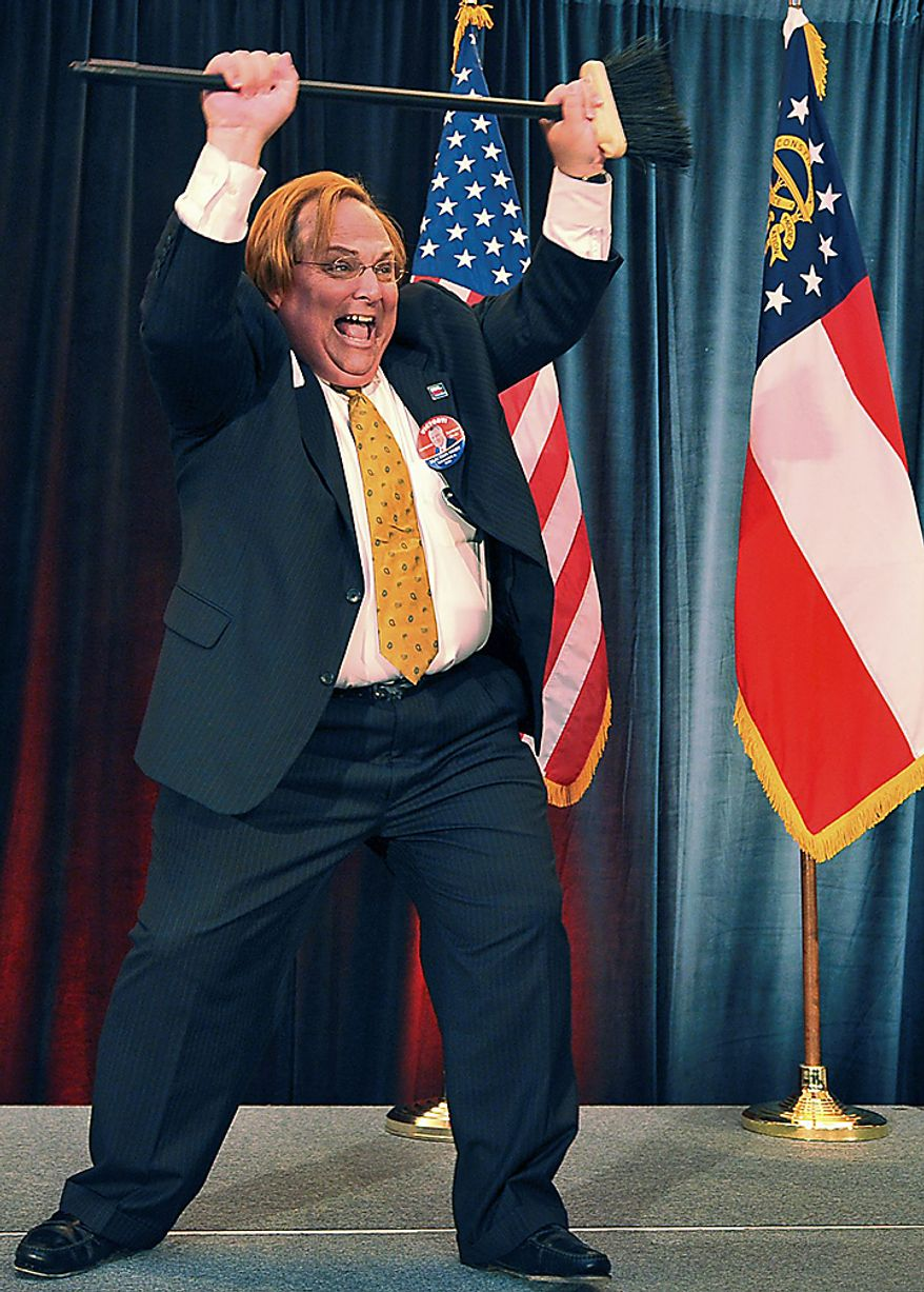 Harris Blackwood, communications director for Georgia Gubernatorial candidate Nathan Deal, holds a broom, claiming a sweep for Republicans at the Georgia Republican Party's election night watch party, Tuesday, Nov. 2, 2010, in Atlanta. (AP Photo/Atlanta Journal & Constitution, Brant Sanderlin)