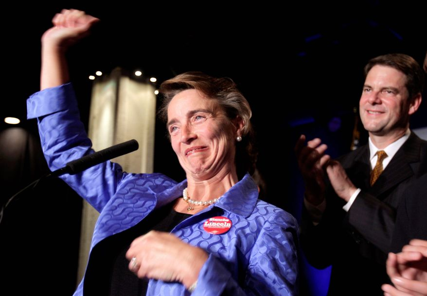 Sen. Blanche Lincoln, Arkansas Democrat, acknowledges her supporters during her concession speech on Tuesday in Little Rock, Ark., as her husband, Steve, looks on. (Associated Press)
