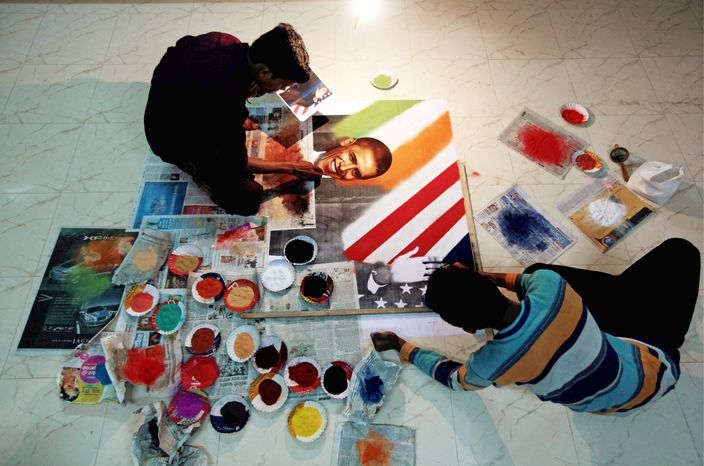"BIG DRAW: Indian artists do work depicting President Obama at a studio near Mumbai. His highly anticipated visit to the subcontinent will coincide with Diwali, ""the festival of lights."" It's the first stop of a 10-day Asian tour beginning Friday. (Associated Press)"