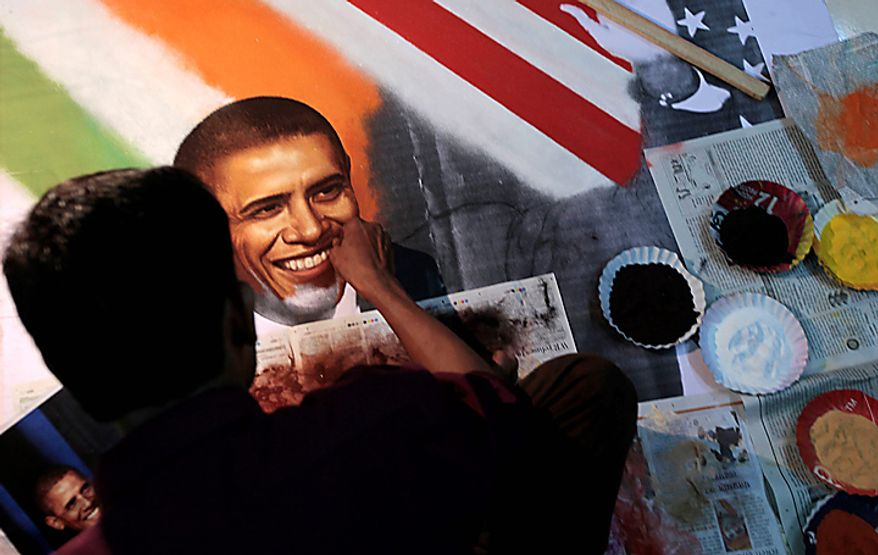 An Indian artist makes an art work depicting President Barack Obama at a studio in Thane, near Mumbai, India, Thursday, Nov. 4, 2010. President Obama is expected to visit India from Nov. 6-9. (AP Photo/Rajanish Kakade)