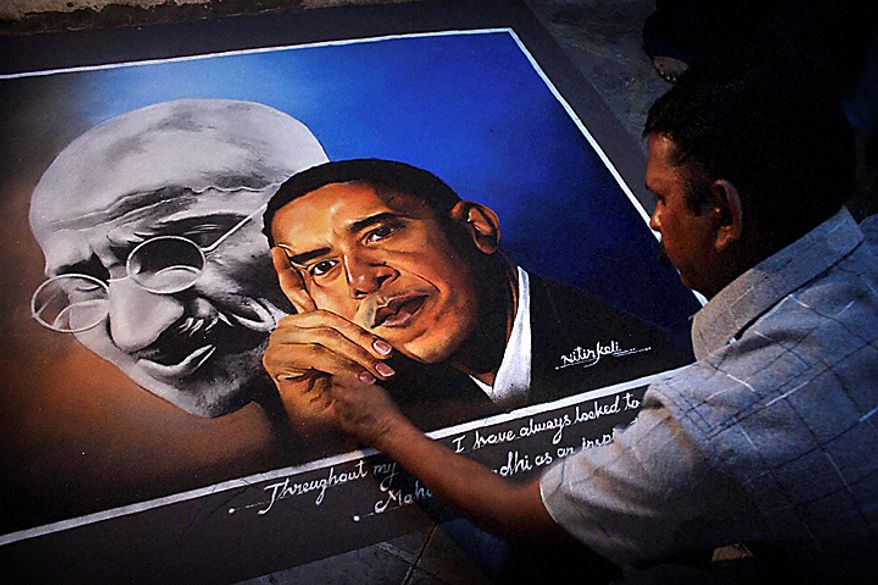 In this photo taken Wednesday, Nov. 3, 2010, an Indian artist works on a painting of President Barack Obama and the late Indian leader Mahatma Gandhi at his studio in Thane, near Mumbai, India. President Obama is expected to visit India from Nov. 6-9 and will include a visit to Gandhi's memorial in New Delhi. (AP Photo)