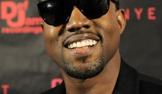 """** FILE ** In this Oct. 18, 2010, file photo, singer Kanye West arrives for a screening of """"Runaway,"""" a short film he directed that will accompany his forthcoming album """"My Beautiful Dark Twisted Fantasy"""" in Los Angeles. (AP Photo/Chris Pizzello, file)"""