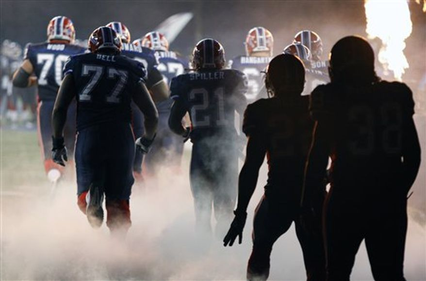 The Buffalo Bills are introduced before the start of an NFL football game against the Chicago Bears at the Rogers Centre in Toronto, Sunday, Nov. 7, 2010. (AP Photo/David Duprey)