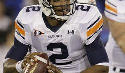 FILE - This Oct. 9, 2010, file photo shows Auburn quarterback Cameron Newton looking for a receiver during the first half of an NCAA college football game against Kentucky,  in Lexington, Ky. A man who said he represented Auburn quarterback and Heisman hopeful Cameron Newton during his recruitment out of junior college last year asked for payment to secure his commitment to Mississippi State, according to former MSU player John Bond.   (AP Photo/Ed Reinke, File)