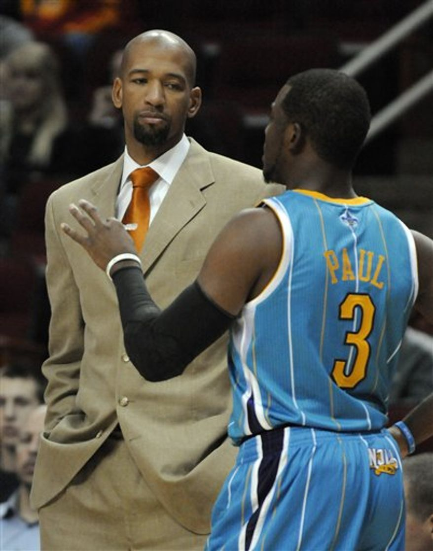 New Orleans Hornets coach Monty Williams, left, talks with Chris Paul (3) before an NBA basketball game against the Houston Rockets on Wednesday, Nov. 3, 2010, in Houston. (AP Photo/Pat Sullivan)