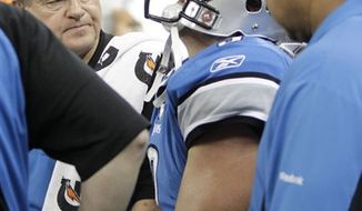 New York Jets coach Rex Ryan talks to players during the fourth quarter of an NFL football game against the Detroit Lions in Detroit on Sunday, Nov. 7, 2010. The Jets won 23-20 in overtime. (AP Photo/Paul Sancya)
