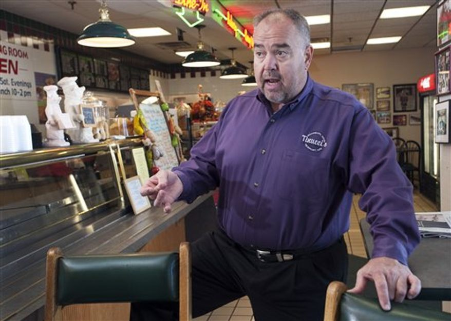 Caterer Gus Tinucci talks about his encounter with NFL football Randy Moss while catering a function for the Minnesota Vikings last week, at Tinucci's store in Newport, Minn., Nov. 4, 2010. Tinucci's plans to offer free lunches Friday to the first 50 people who come to turn in their Moss jerseys, after the Vikings waived Moss after 26 days with the team. (AP Photo/Craig Lassig)