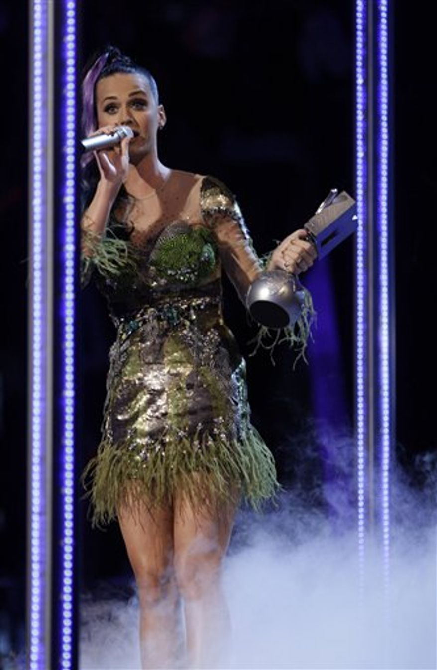 Ke$ha reacts after receiving the award for Best New Act at the MTV European Music Awards 2010, in Madrid, Sunday, Nov. 7, 2010. (AP Photo/Joel Ryan)