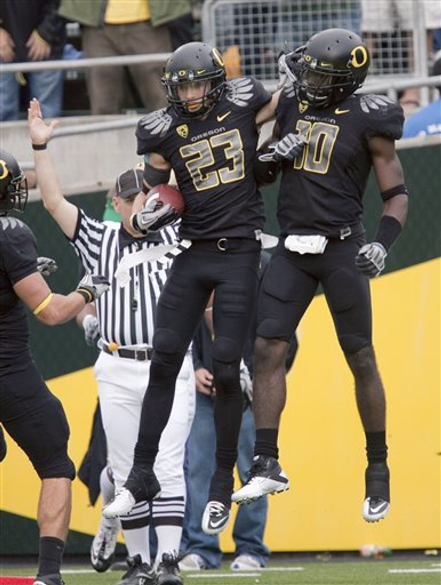 Oregon  wide receiver Jeff Maehl (23) celebrates with  wide receiver D.J. Davis (10) after scoring during the second half of an NCAA college football game against Washington Saturday, Nov. 6, 2010, in Eugene, Ore. (AP Photo/Steven Nehl)