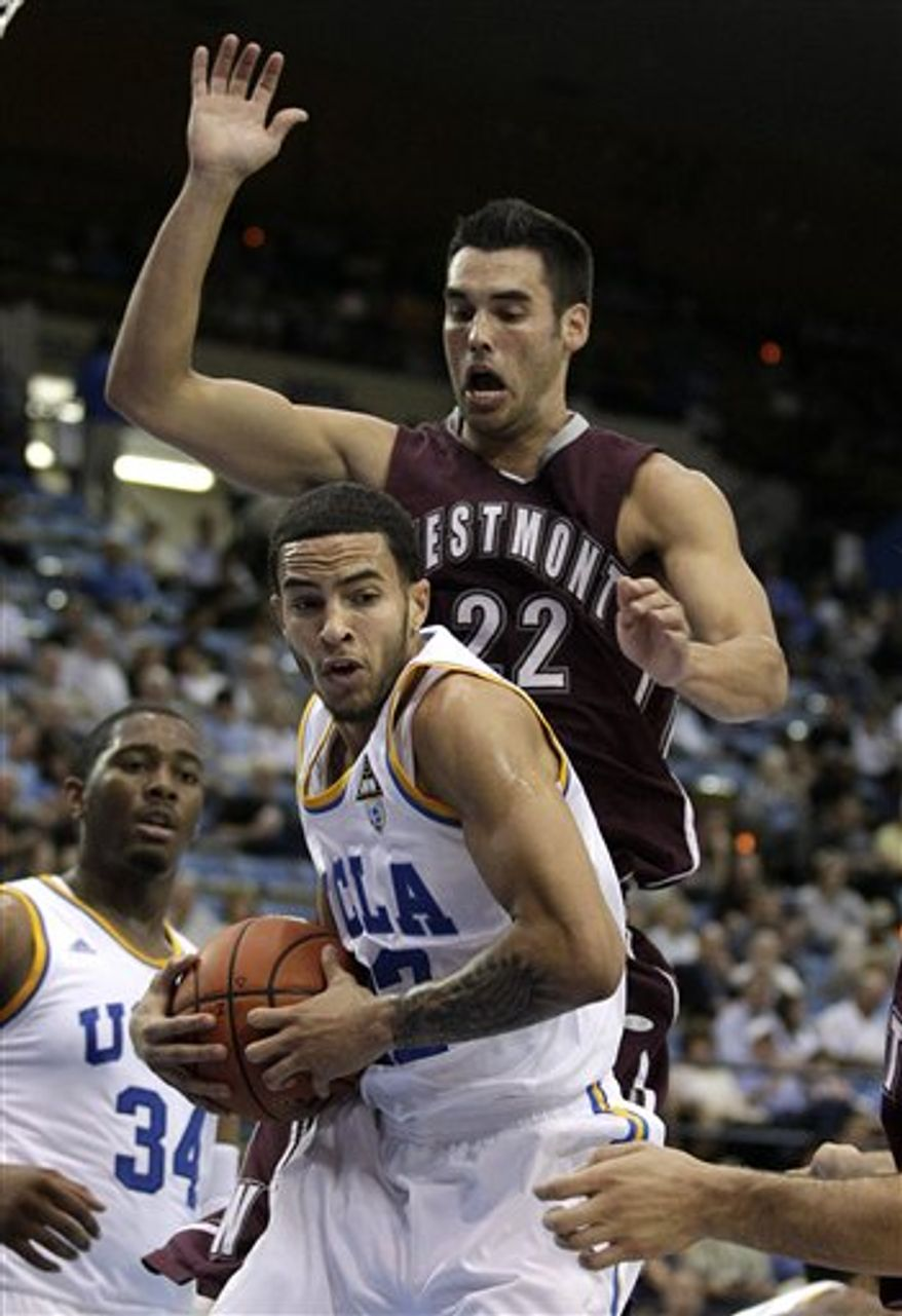 UCLA's Tyler Honeycutt, bottom, gets a rebound against Westmont's Blake Bender during the first half of an NCAA college exhibition basketball game in Los Angeles, Thursday, Nov. 4, 2010. (AP Photo/Jae C. Hong)