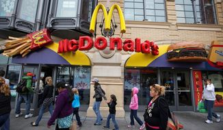 The McDonald's restaurant at Fisherman's Wharf in San Francisco attracts people with children. The recession-driven search for value is boosting patronage at fast-food restaurants. (Associated Press)