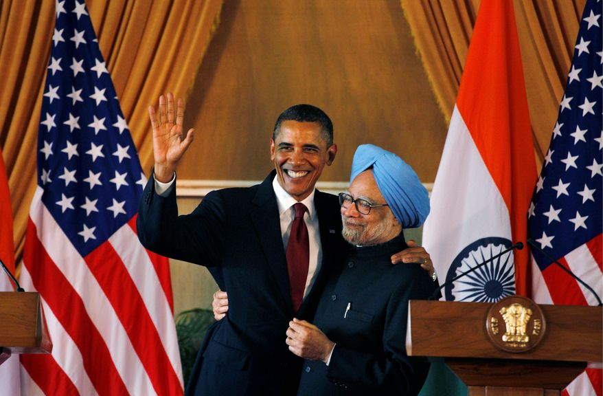 President Obama and Indian Prime Minister Manmohan Singh share a moment after a joint statement and press conference at Hyderabad House in New Delhi. Mr. Obama was on a three-day visit. He next travels to Indonesia en route to Seoul for a Group of 20 summit on global finance. (Associated Press)