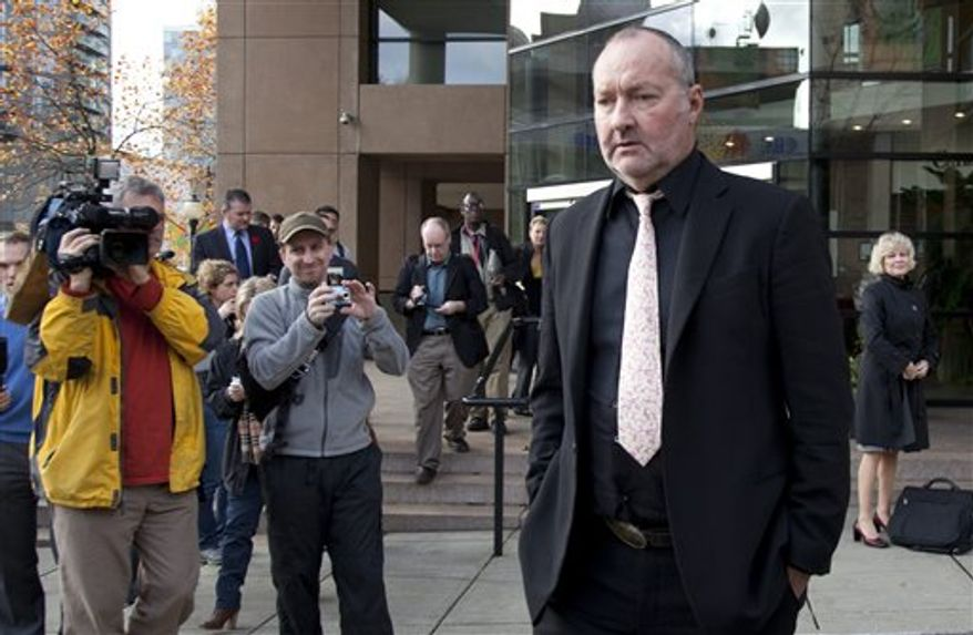 Actor Randy Quaid leaves the Immigration and Refugee Board offices following his immigration hearing in Vancouver, Monday, Nov. 8, 2010. Quaid and his wife Evi were arrested in Vancouver last month on warrants from the U.S., prompting them to make their now-infamous refugee claim. (AP Photo/The Canadian Press, Jonathan Hayward)