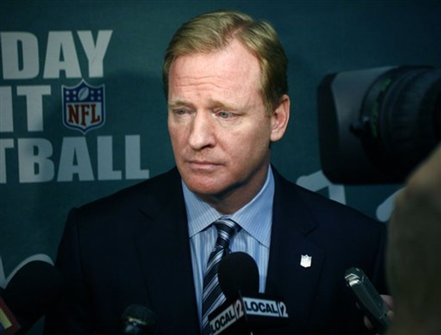 NFL commissioner Roger Goodell, left, stands with Cincinnati Bengals president Mike Brown, right, during a program promoting the Monday night football game against the Pittsburgh Steelers, Monday, Nov. 8, 2010 in Cincinnati. Goodell says active NFL players won't be deciding punishment for flagrant hits that merit fines. He is open to listening to them, though, and says his meeting last week with Pittsburgh's James Harrison was meant to get his opinions on the league's crackdown.  (AP Photo/David Kohl)