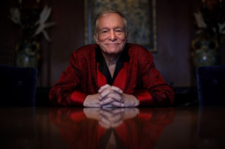 Playboy magazine founder Hugh Hefner poses for photos at the Playboy Mansion in Los Angeles, Thursday, Nov. 4, 2010. (AP Photo/Jae C. Hong)