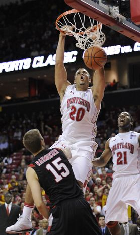 ** FILE ** Maryland's Jordan Williams (20) dunks against Seattle's Chad Rasmussen (15) during the first half of an NCAA college basketball game, Monday, Nov. 8, 2010, in College Park, Md. Also seen is Maryland's P