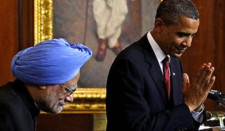 ** FILE ** President Obama (right) bows as he makes a greeting to the audience beside Indian Prime Minister Manmohan Singh after delivering a speech at Parliament House in New Delhi on Monday, Nov. 8, 2010. (AP Photo/Jim Young, Pool)