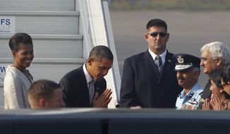 U.S. President Barack Obama, greets the Indian delegation present at the airport to see him off in the traditional Indian way of namaste as he leaves for Indonesia at the end of their tour of India, at the airport in New Delhi, India, on Tuesday, Nov. 9, 2010. (AP Photo/Saurabh Das)