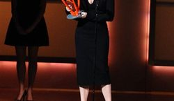 President of Lithuania Dalia Grybauskaite accepts her award at the 20th annual Glamour Women of the Year Awards at Carnegie Hall in New York, on Monday, Nov. 8, 2010. (AP Photo/Peter Kramer)