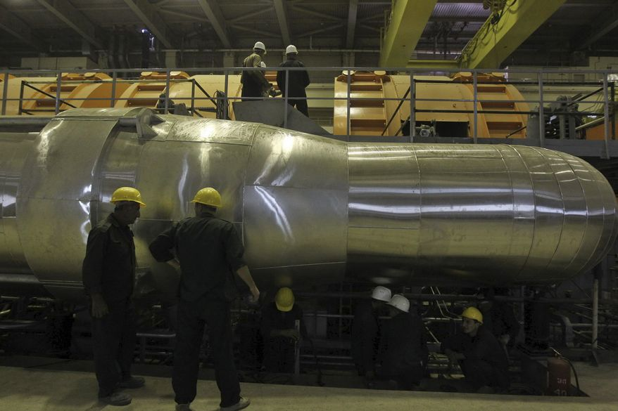 **FILE** Iranian workers work in a part of the electricity generating plant of the Bushehr nuclear power plant in Iran on Oct. 26, 2010. (Associated Press/Mehr News Agency, Majid Asgaripour)
