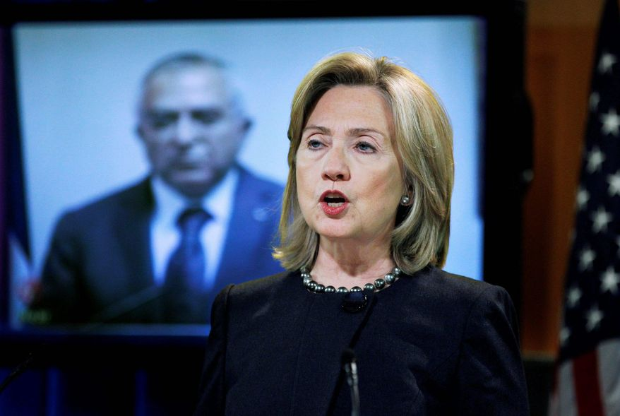 Secretary of State Hillary Rodham Clinton announces the transfer of budget assistance funds to the Palestinian Authority during a video conference Wednesday with Palestinian Prime Minister Salam Fayyad (background) in Washington. (Associated Press)