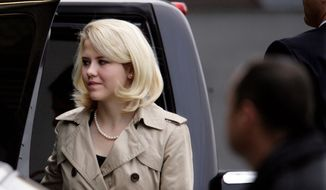 Victim Elizabeth Smart arrives at the federal courthouse in Salt Lake City to testify Wednesday in the Brian David Mitchell trial. He is charged with kidnapping and unlawful transportation of a minor across state lines in 2002. If convicted, he faces a life sentence. (Associated Press)