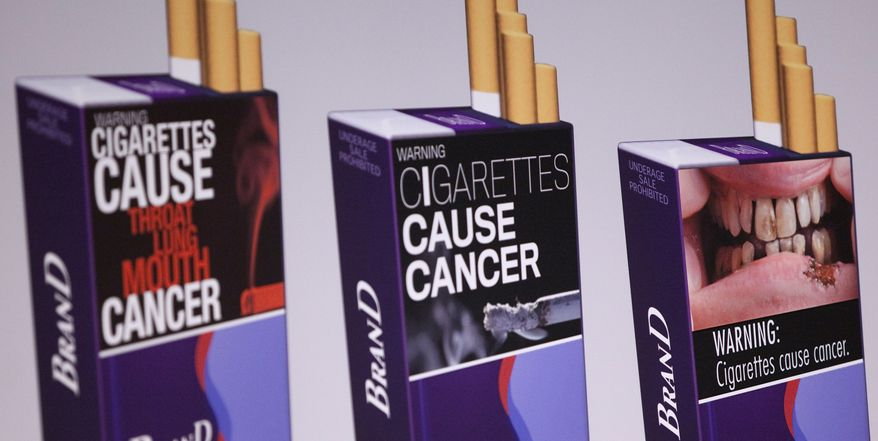 Three examples of proposed warning graphics that will appear on cigarette packaging as part of the government's new tobacco prevention efforts, seen in Washington, Wednesday, Nov. 10, 2010. (AP Photo/Evan Vucci)