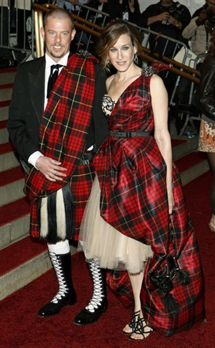 In this Monday, May 1, 2006 file picture, designer Alexander McQueen poses with Sarah Jessica Parker during arrivals at the Costume Institute Gala at the Metropolitan Museum of Art in New York. The Costume Institute of The Metropolitan Museum of Art will honor the memory _ and the fashion vision _ of the late designer Alexander McQueen through a retrospective exhibit in 2011. (AP Photo/Stuart Ramson)