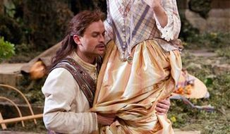 """In this Nov. 3, 2010 photo provided by the Metropolitan Opera, Danielle de Niese perfroms as Despina  in Mozart's """"Cosi Fan Tutte"""" during the rehearsal at the Metropolitan Opera in New York. (AP Photo/Metropolitan Opera, Marty Sohl)"""