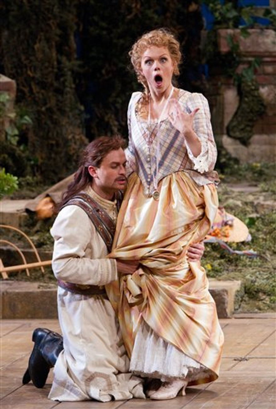"In this Nov. 3, 2010 photo provided by the Metropolitan Opera, Danielle de Niese perfroms as Despina  in Mozart's ""Cosi Fan Tutte"" during the rehearsal at the Metropolitan Opera in New York. (AP Photo/Metropolitan Opera, Marty Sohl)"