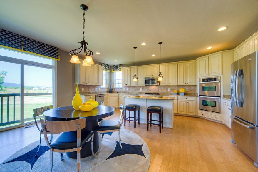 The Kingston II model at Village Green has a center-island kitchen with a breakfast area and pantry. The home, which has nearly 3,000 finished square feet, can be expanded with a morning room, a sunroom, a rear extension and a finished lower level.