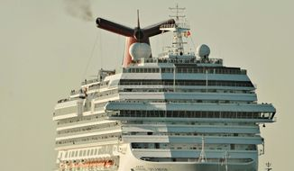 ** FILE ** Tugboats guide the disabled cruise ship Carnival Splendor into San Diego Bay. The luxury liner, which lost power with nearly 4,500 passengers and crew aboard, was towed from the Pacific Ocean off the coast of Mexico. (Associated Press)