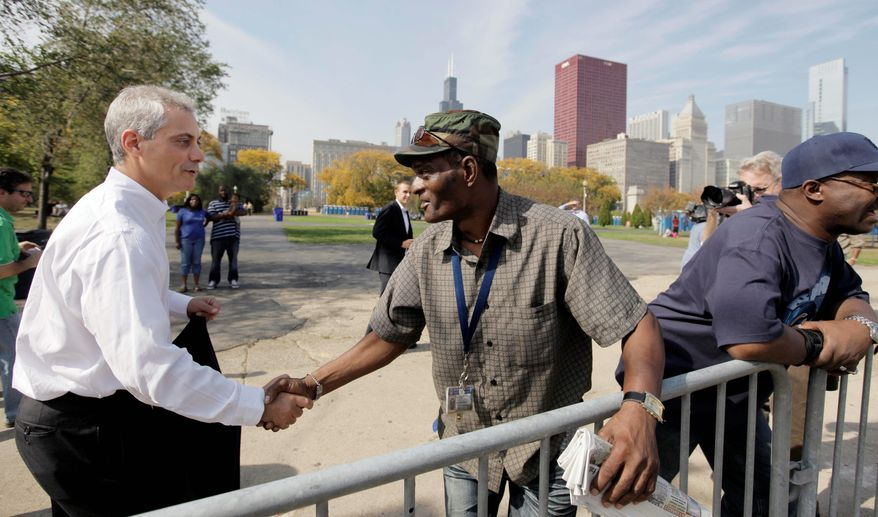 Former Obama White House Chief of Staff Rahm Emanuel shakes hands Oct. 11 along the route of Chicago's Columbus Day parade as he prepares to run to replace outgoing Mayor Richard M. Daley. (Associated Press)