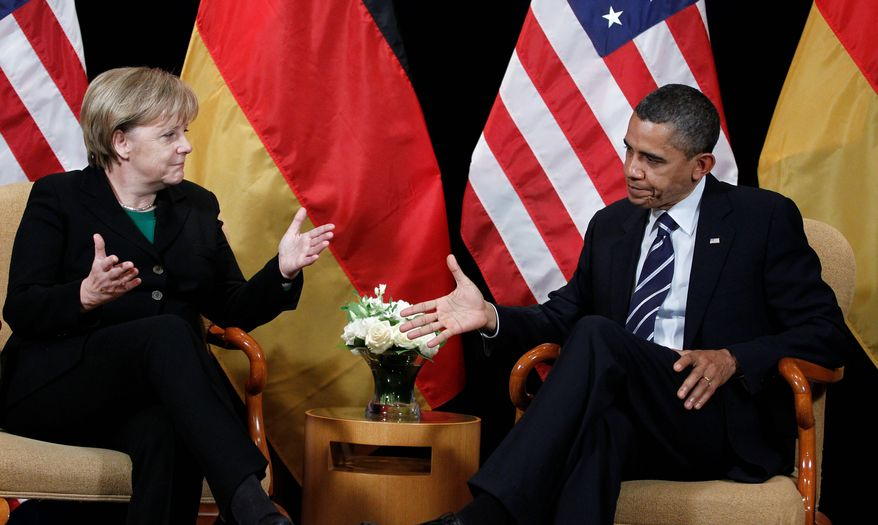 """President Obama meets with German Chancellor Angela Merkel on the sidelines of the G-20 summit Thursday in Seoul. She rejected a U.S. proposal to try to cap global trade imbalances. """"To set political limits on trade surpluses and deficits is neither economically justified nor politically appropriate,"""" she told the G-20 business summit. (Associated Press)"""