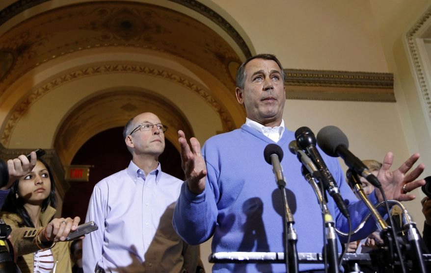House Speaker-in-waiting John Boehner of Ohio, right, accompanied by Republican Majority Transition Chairman Rep. Greg Walden, R-Ore., speaks during a news conference on Capitol Hill in Washington on Wednesday, Nov. 10, 2010. (AP Photo/Alex Brandon)