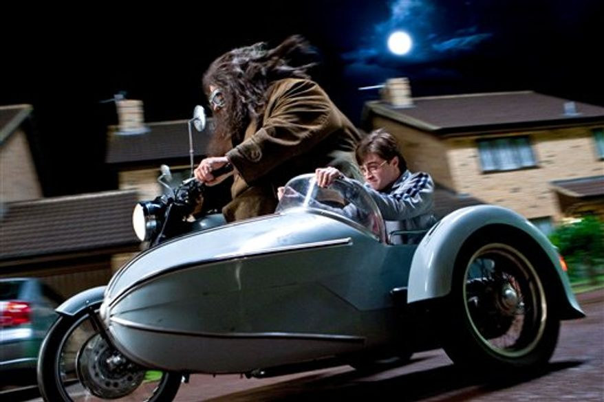 """In this film publicity image released by Warner Bros. Pictures, Robbie Coltrane, left, and Daniel Radcliffe are shown in a scene from """"Harry Potter and the Deathly Hallows: Part 1.""""  (AP Photo/Warner Bros. Pictures, Jaap Buitendijk) NO SALES"""