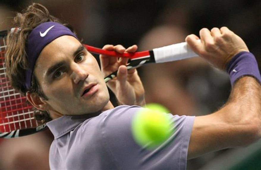 Roger Federer of Switzerland returns the ball to Richard Gasquet of France during their match of the Paris Tennis Masters tournament, Wednesday, Nov. 10, 2010. (AP Photo/Lionel Cironneau)