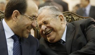 In this June 27, 2009, file photo, Iraq's Prime Minister Nouri al-Maliki, left, and President Jalal Talabani, right, react, at a ceremony marking the 2003 death of Mohammed Baqir al-Hakim in Baghdad. (AP Photo/Hadi Mizban, File)