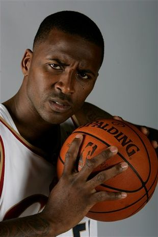 FILE - In this Sept. 29, 2008, file photo, Cleveland Cavaliers' Lorenzen Wright poses at the NBA basketball team's media day in Independence, Ohio. An autopsy shows former NBA player Lorenzen Wright, whose body was found in July, died after being shot at least five times. The autopsy report released Wednesday, Nov. 10, 2010 by the Shelby County, Tenn., Medical Examiner says Wright was shot twice in the head, twice in the chest and once in the right forearm. (AP Photo/Mark Duncan, File)