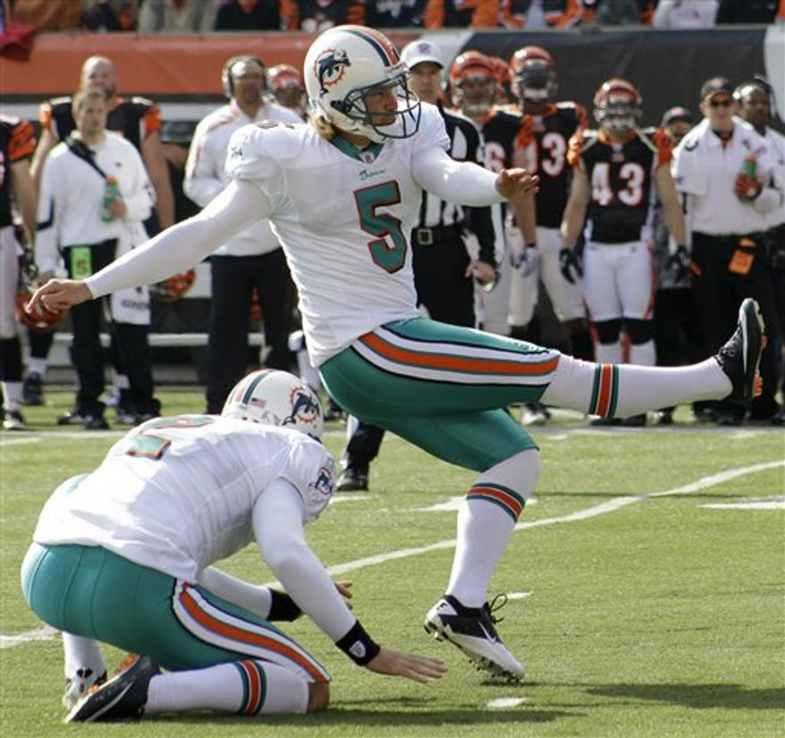 FILE - This Oct. 31, 2010, file photo shows Miami Dolphins place kicker Dan Carpenter (5) kicking a field goal against the Cincinnati Bengals in the first half of an NFL football game, in Cincinnati.  (AP Photo/Al Behrman, File)
