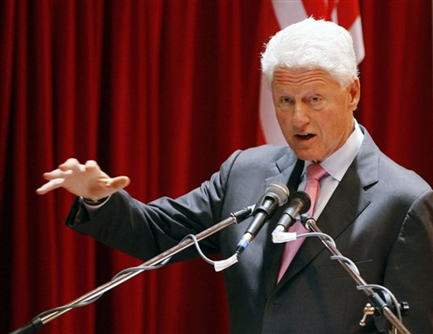 Former U.S. President Bill Clinton gestures as he delivers his keynote address at INTI International University in Nilai, Negeri Sembilan, Malaysia, Friday, Nov. 12, 2010. (AP Photo/Lai Seng Sin)